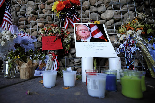 A makeshift memorial stands outside the offices of the late US Senator John McCain in Phoenix, Arizona. Picture: REUTERS/BRIAN SNYDER