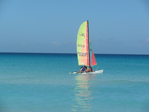 A HobieCat catamaran in the clear tropical waters of Cuba.