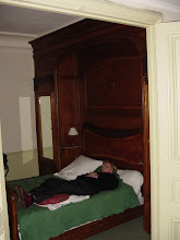 Photo: Our room has this large built-in bed: on one side the door is an armoire, on the other side the entrance to the bathroom. Here, Diane checks out the equipment.