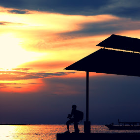 a photographer looking for inspiration under sunset by Hilmi Photowork - Landscapes Sunsets & Sunrises ( nature, sunset, indonesia, seascape, photography,  )