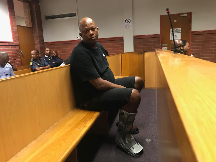 Mandla 'Mampintsha' Maphumolo appears in court with a cast on his right leg