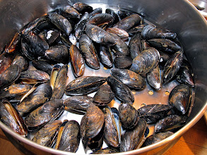 Photo: mussels steamed just enough so that they begin to open, for making mussel cakes