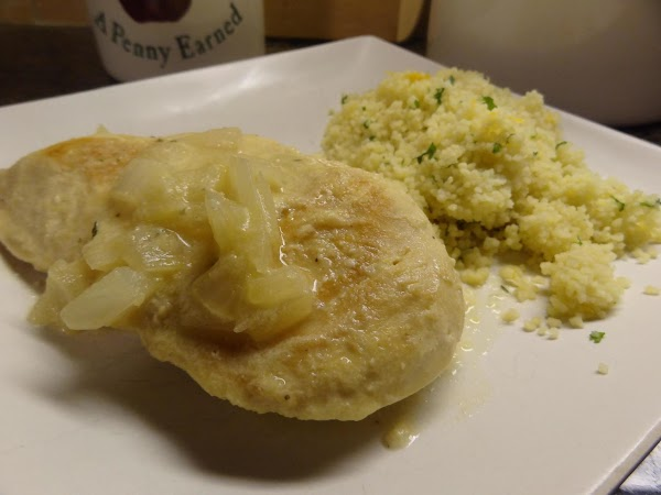 To serve, scoop 1/3 cup couscous onto plate, put breast on top and cover...