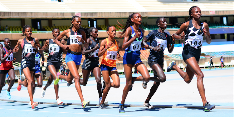 Hellen Obiri leads a pack in 10,000m race during the second AK Track and Field series at Moi Stadium, Kasarani.