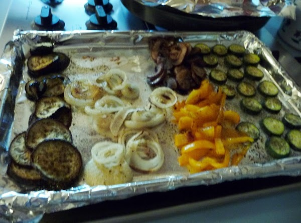 Slice the veggies about a 1/2 inch thick.  Spray a cookie sheet and...