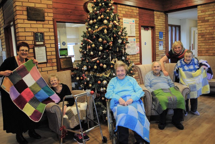 Staff get knitting for local community