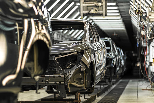 Cars are shown being assembled at an automotive factory. Picture: 123RF/ VADIMALEKCANDR