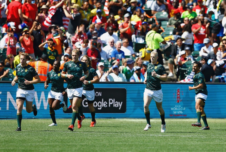 Philip Snyman of South Africa (3rd L) leads out the players during the Men's match between South Africa and Scotland on day 2 of the Rugby World Cup Sevens 2018 at AT&T Park on July 21, 2018 in San Francisco, United States of America.