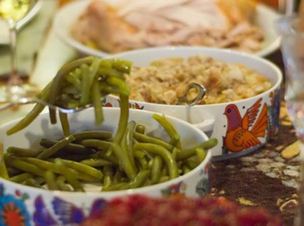 Next add all your leftover turkey, side dishes, dressings, mashed potato, and veggies. Let...