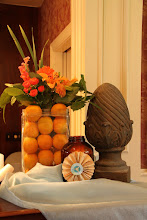 """Photo: The antique Bar at Old Shawnee Towne, Oranges, and cat tails in an antique battery """"box"""". Design by Marietta Floral by Kelly!"""