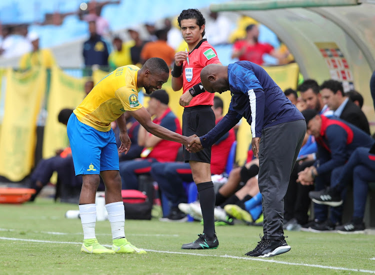Sibusiso Vilakazi shake hands with his coach Pitso Mosimane during the match.