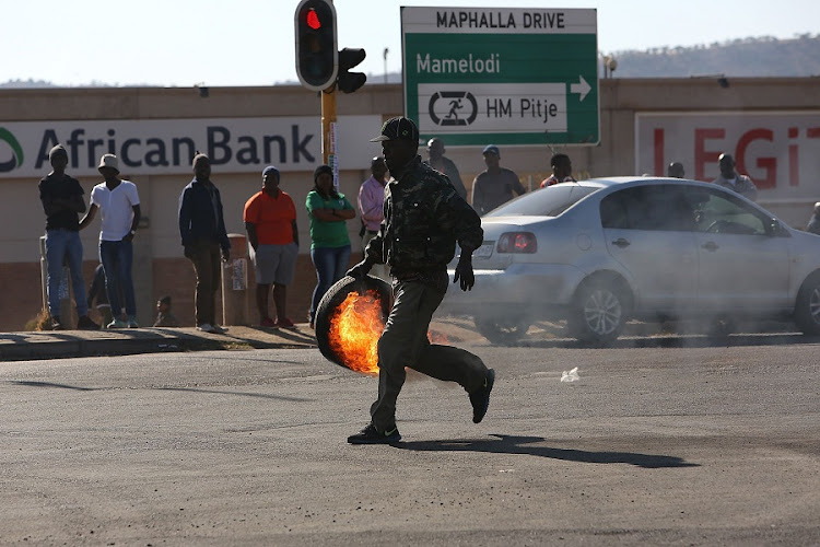 Protesters blockade the road in Pretoria on June 21. Picture: THE TIMES/ALON SKUY