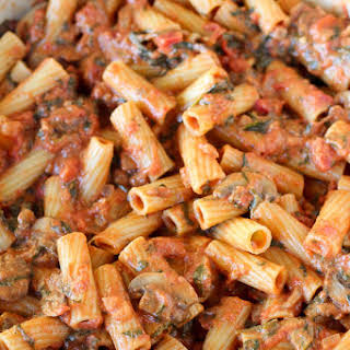 Pasta with Mushrooms and Spinach in Tomato Cream Sauce.