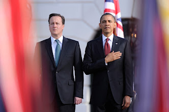 Photo: British Prime Minister Cameron and President Barack Obama meet upon the arrival of Cameron and his wife, Samantha Cameron, to the White House on Wednesday. Photo by Jack Gruber, USA TODAY.