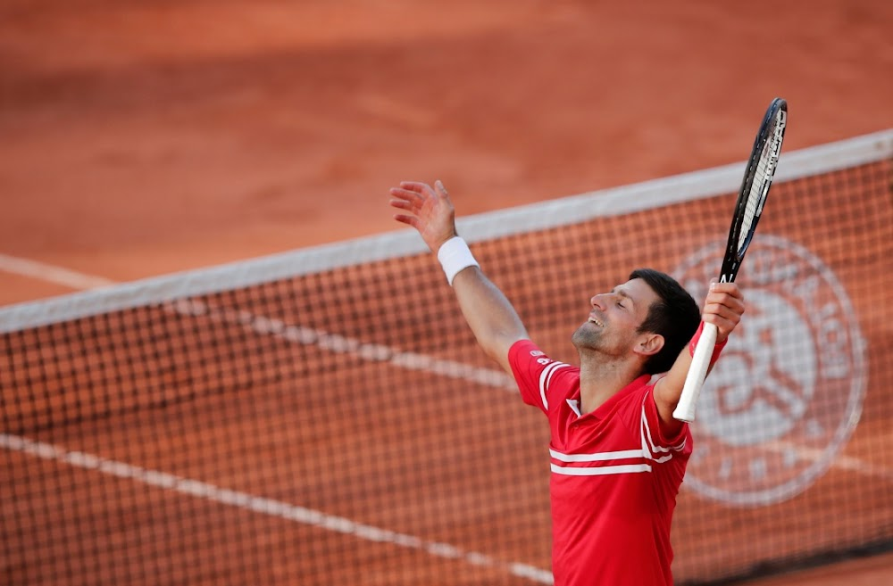 Djokovic shows true grit in French Open epic