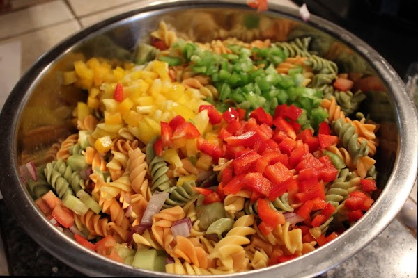 Chop all vegetables & add to pasta, mix in well.