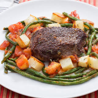 Steaks & Roasted Potatoes with Sautéed Long Beans & Tomato.