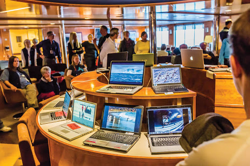 National-Geographic-Explorer-laptop-gallery.jpg - Guests from the Lindblad Expedition ship National Geographic Explorer charge up their laptops in the lounge.