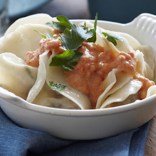 Pork and Veal Ravioli with Creamy Tomato Sauce