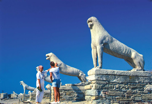 Visit the impressive ancient monument the Terrace of the Lions during a visit to the island of Delos, Greece.