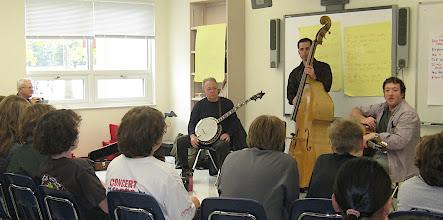 Photo: Jerry Oland (banjo), Rick Brodsky (bass), Aaron Lieberman (guitar)