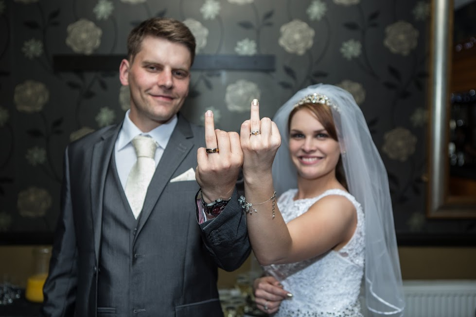 wedding-couple-showing-middle-finger