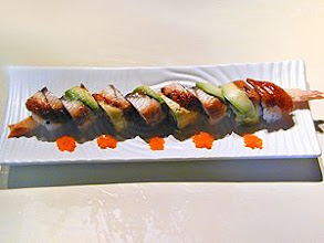Photo: Dragon Roll : A Tempura Roll covered with eel and avocado with tobiko on the side.