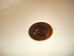 Photo: The shower drain is just gross...needs a good cleaning and scrubbing!