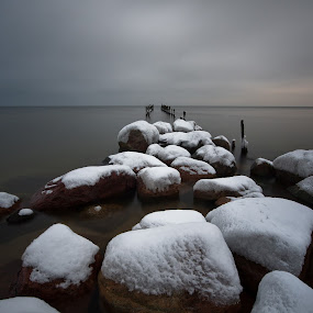 White stones by Eriks Zilbalodis - Landscapes Waterscapes ( mole, winter, snow, white, pier, sea, grey, stones )