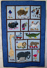 Photo: This Jungle Walk quilt was made by Debbie Best, Maryville, TN for herself as she loved the pattern. Take a closer look and you will see the pink satin slippers on the hippo and fur lining on the Zebra's Uggs. Great quilt Debbie.
