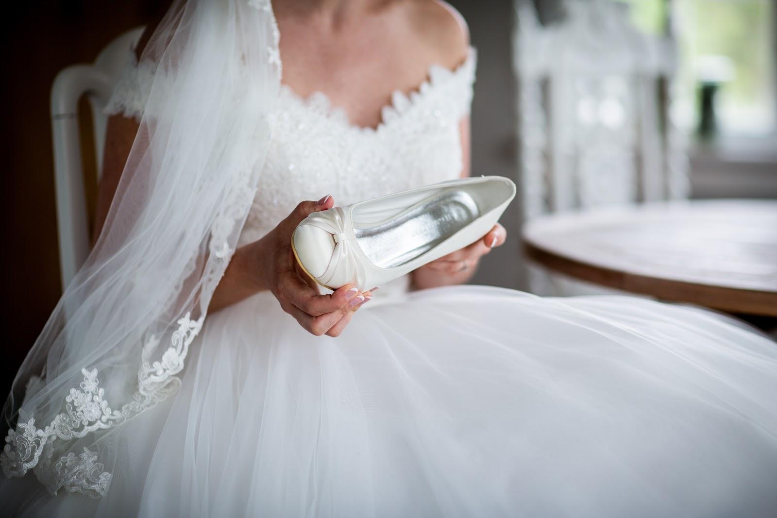 A bride in a white, Western style wedding dress.
