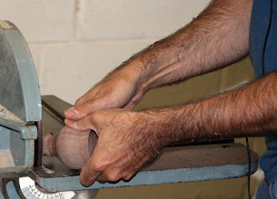 Photo: From there, he goes to the disc sander to remove more material from the stem.