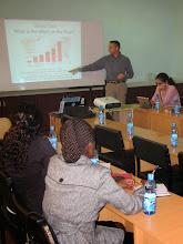 Photo: Will Ruddick giving a seminar at the University of Nairobi on Community Currencies