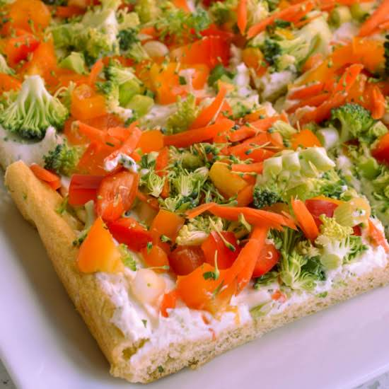 This Fun And Easy Appetizer Veggie Pizza Is Made With A Three Ingredient Ranch Cream Cheese Spread And Topped With An Assortment Of Finely Chopped Vegetables And Herbs.