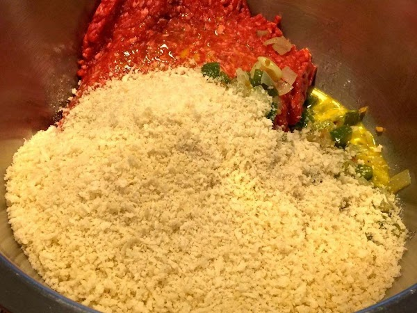 In a large mixing bowl, combine the ground meat, eggs, cooked vegetables, bread crumbs,...