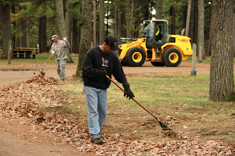 Photo: Mr. Jay Brezinka of the Camp Ripley Environmental Office joins SFC Dan Feely in raking leaving around the Camp Ground of De Parcq Woods during Earth Day Clean up May 9, 2013. http://www.minnesotanationalguard.org/press_room/e-zine/articles/index.php?item=4402