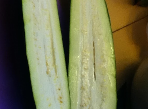 PREPARE ZUCCHINI BOAT: Cut zucchini in half lengthwise.  *If you are using a LARGE (over...