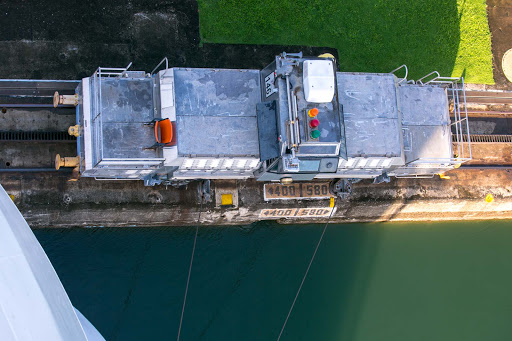 "panama-canal-mule.jpg - A look down at an electric locomotive, or ""mule,"" alongside Norwegian Jade in a Panama Canal lock."