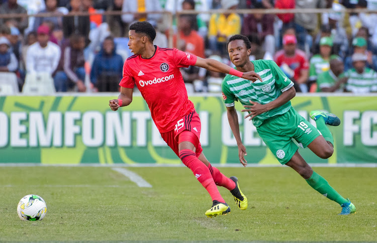 Orlando Pirates winger Vincent Pule (L) leaves Bongani Sam (R) of Bloemfontein Celtic in his wake during the Absa Premiership match at Toyota Free State Stadium in Bloemfontein on August 19 2018.
