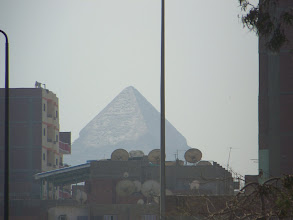 Photo: If it weren't for the bad pollution and multitude of buildings in Cairo, you'd be able to see the pyramids from anywhere in the city.  Even still, you can see them from several miles away if you catch a glimpse through the buildings on a clear day.  Here we were a few miles away.