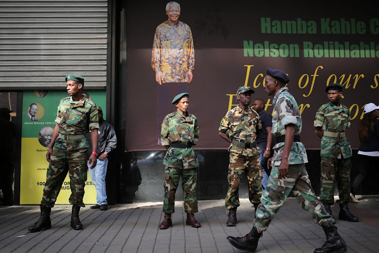Members of the Umkhonto We Sizwe Military Veterans Association (MKMVA) stand guard at the ANC headquarters in downtown Johannesburg. File photo.