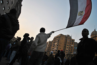 Photo: An Egyptian flag flies high into the evening as clashes continue...