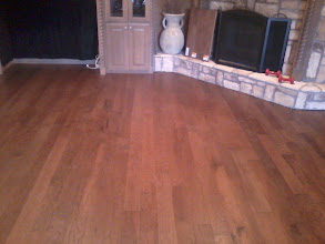 Photo: Bruce flooring from floor one hand scraped under cut fire place