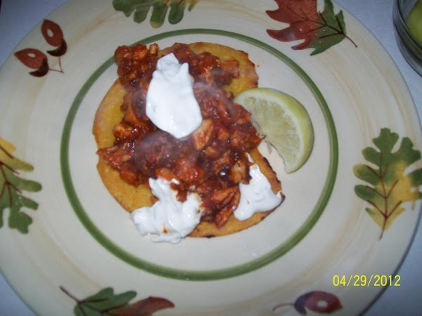 Top each fried tortilla with the chicken mixture and top with sour cream. Drizzle...