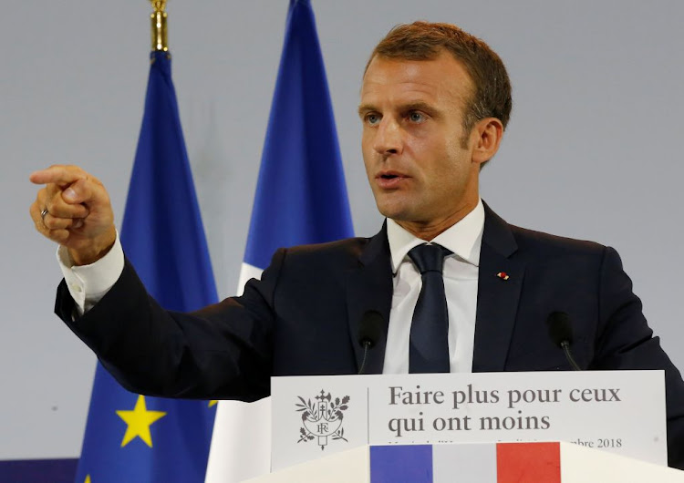 French President Emmanuel Macron delivers a speech on poverty in Paris on Thursday, September 13 2018. Macron is set to acknowledge that mathematician Maurice Audin, an pro-Algerian independence activist who disappeared in 1957, died under torture.