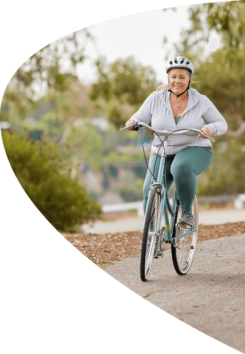 Woman riding bike in park