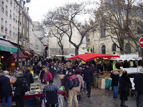 Photo: The next day is New Year's Eve (often referred to here as St. Sylvestre, after the day's patron saint) and there is a big crowd shopping on the Rue Mouffetard – La Mouffe to locals.