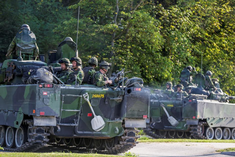 Swedish armoured personnel carriers are seen in Visby harbour, island of Gotland, Sweden September 14, 2016. Picture: TT News Agency/ Soren Andersson/ via REUTERS