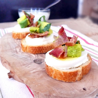 Bacon and Egg Crostini with Roasted Garlic Aioli and Avocado