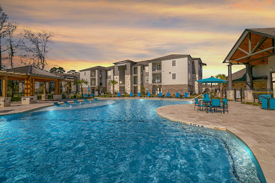 Landmark at Auburn Lakes Apartments sparkling swimming pool at dusk